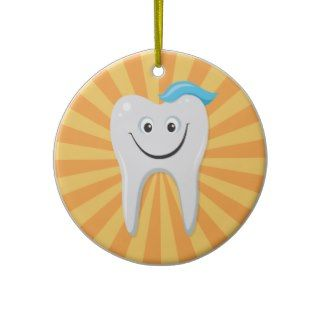 Happy cartoon tooth on yellow background christmas tree ornaments