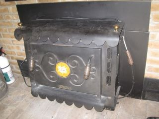 Wood Stove Insert A RARE Earth Stove Model 101 for Pickup Only