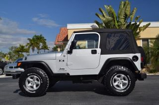 Lifted 4x4 Florida Wrangler 33 inch Tires 5 Speed Air Conditioning 63K Miles 4 0