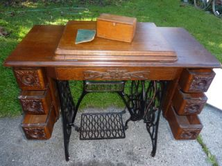 Singer 66 Treadle Sewing Machine in Carved Oak Cabinet 1913